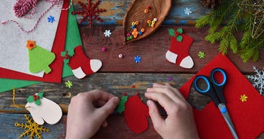 Child making Christmas craft