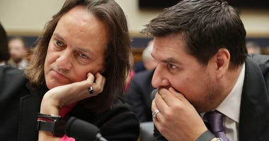 WASHINGTON, DC - MARCH 12: T-Mobile CEO John Legere (L) and Executive Director of Sprint Marcelo Claure talk before testifying to the House Judiciary Committee's Antitrust, Commercial and Administrative Law Subcommittee in the Rayburn House Office Buildin