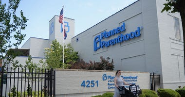 ST LOUIS, MO - JUNE 04: A women stands with her child in a stroller during a pro-life rally outside the Planned Parenthood Reproductive Health Center on June 4, 2019 in St Louis, Missouri. The fate of Missouri's lone abortion clinic could be decided today