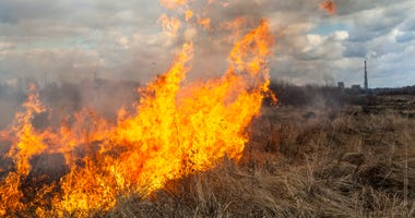 Photo of grass burning in a prairie.