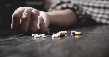 Young person passed out or dead from drug overdose.