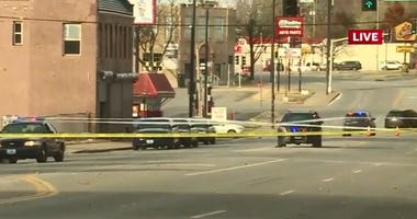 Crime scene tape surrounds the site of a homicide in Kansas City.