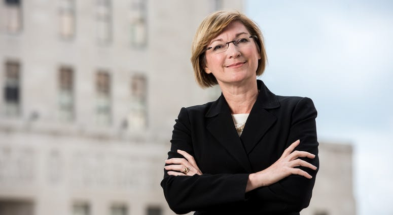 Jackson County Prosecutor Jean Peters Baker official portrait, standing in front of courthouse