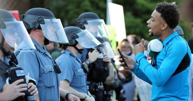 A demonstrator yells at police officers during a protest on May 31, 2020 in Kansas City, Missouri. Protests erupted around the country in response to the death of George Floyd in Minneapolis, Minnesota while in police custody.