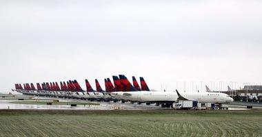 Planes belonging to Delta Air Lines sit idle at Kansas City International Airport on April 03, 2020 in Kansas City, Missouri.