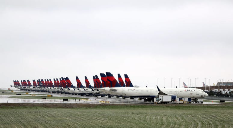 Planes belonging to Delta Air Lines sit idle at Kansas City International Airport on April 03, 2020 in Kansas City, Missouri.