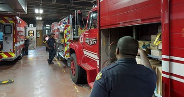 Firefighters standing inside station in Kansas City, Kansas