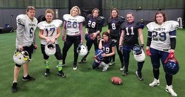 Women's football players post for menacing team photo