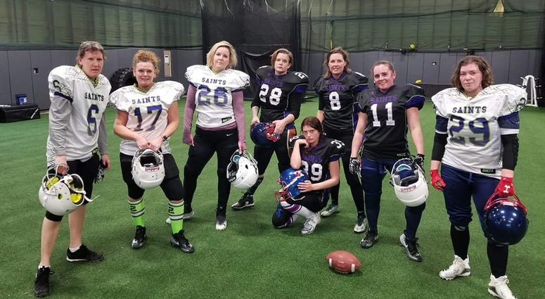 Women's football players post for menacing team photo