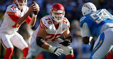 Laurent Duvernay-Tardif #76 of the Kansas City Chiefs blocks Corey Liuget #94 of the San Diego Chargers during a game at Qualcomm Stadium on November 22, 2015 in San Diego, California.