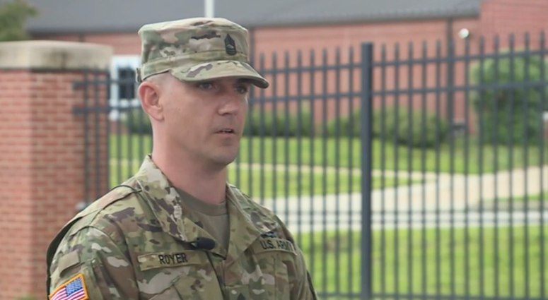 Master Sergeant David Royer speaks to reporters the day after running over a gunman on the Centennial Bridge in Leavenworth, Kansas.