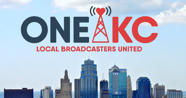ONEKC logo floating over downtown Kansas City