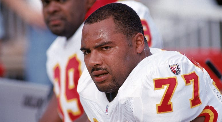 Defensive end Pellom McDaniels #77 of the Kansas City Chiefs takes a rest on the bench during a game against the Oakland Raiders at the Oakland/Alameda County Coliseum on December 3, 1995 in Oakland, California. The Chiefs won 29-23.