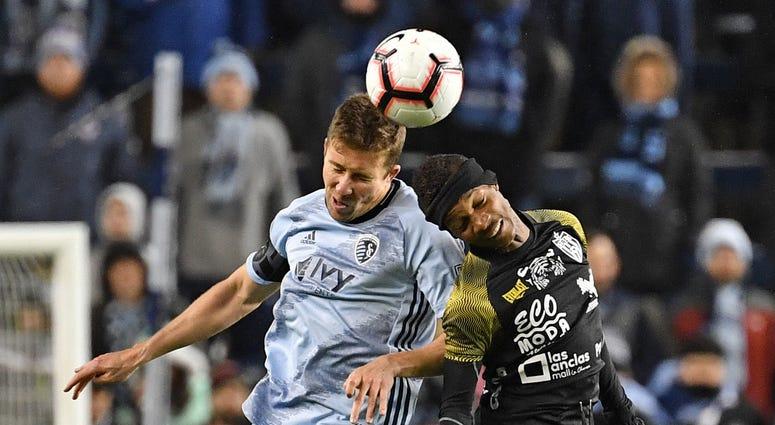 Mar 14, 2019; Kansas City, KS, USA; Sporting Kansas City defender Matt Besler (5) heads the ball against Independiente forward Romeesh Ivey (22) during the second half at Children's Mercy Park.