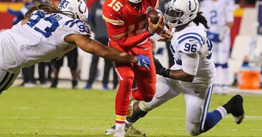 Oct 6, 2019; Kansas City, MO, USA; Kansas City Chiefs quarterback Patrick Mahomes (15) is sacked by Indianapolis Colts defensive end Jabaal Sheard (93) and defensive tackle Denico Autry (96) during the second half at Arrowhead Stadium. Mandatory Credit: J