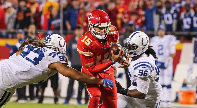 Oct 6, 2019; Kansas City, MO, USA; Kansas City Chiefs quarterback Patrick Mahomes (15) is sacked by Indianapolis Colts defensive end Jabaal Sheard (93) and defensive tackle Denico Autry (96) during the second half at Arrowhead Stadium. Mandatory Credit: J
