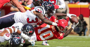 Oct 13, 2019; Kansas City, MO, USA; Kansas City Chiefs wide receiver Tyreek Hill (10) catches a pass for a touchdown against Houston Texans cornerback Phillip Gaines (29) and strong safety Justin Reid (20) and strong safety Jahleel Addae (37) during the f