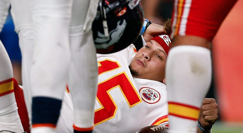 Oct 17, 2019 Kansas City Chiefs quarterback Patrick Mahomes (15) lies on the ground after a play in the second quarter against the Denver Broncos at Empower Field at Mile High.