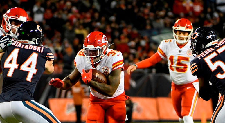 Dec 22, 2019; Chicago, Illinois, USA; Kansas City Chiefs running back Spencer Ware (39) runs against the Chicago Bears during the first half at Soldier Field. Mandatory Credit: David Banks-USA TODAY Sports