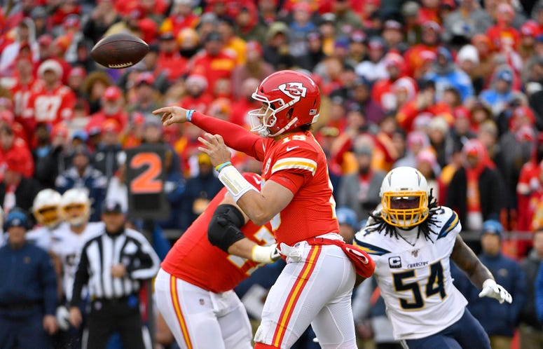 Dec 29, 2019; Kansas City, Missouri, USA; Kansas City Chiefs quarterback Patrick Mahomes (15) throws a pass during the first half against the Los Angeles Chargers at Arrowhead Stadium. Credit: Denny Medley-USA TODAY Sports
