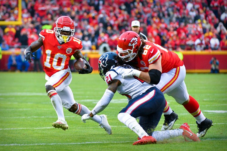 Jan 12, 2020; Kansas City, MO, USA; Kansas City Chiefs wide receiver Tyreek Hill (10) runs with the ball against the Houston Texans during the third quarter in a AFC Divisional Round playoff football game at Arrowhead Stadium. Credit: Denny Medley-USA TOD