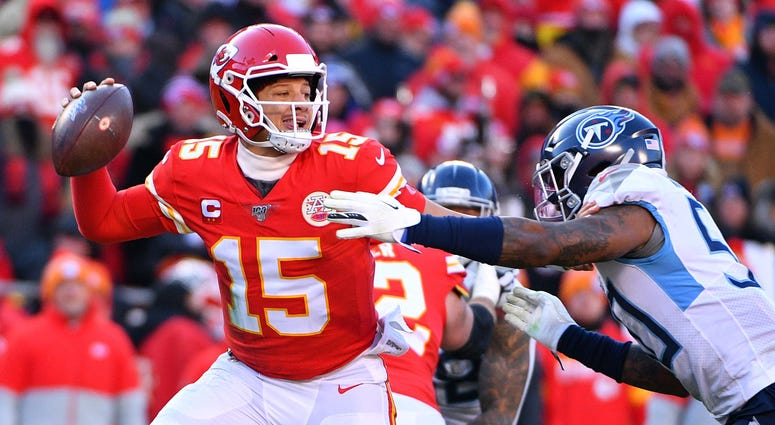 Jan 19, 2020; Kansas City, Missouri, USA; Kansas City Chiefs quarterback Patrick Mahomes (15) throws a pass against Tennessee Titans linebacker Derick Roberson (50) during the first half in the AFC Championship Game at Arrowhead Stadium. Mandatory Credit: