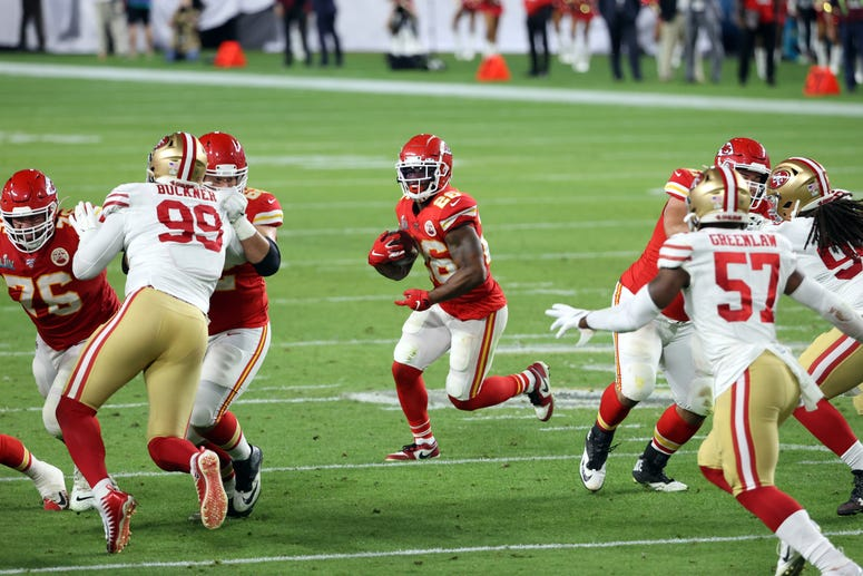 Feb 2, 2020; Miami Gardens, Florida, USA; Kansas City Chiefs running back Damien Williams (26) carries the ball against the San Francisco 49ers during the first quarter in Super Bowl LIV at Hard Rock Stadium. Mandatory Credit: Geoff Burke-USA TODAY Sports