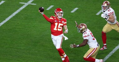 Feb 2, 2020; Miami Gardens, Florida, USA; Kansas City Chiefs quarterback Patrick Mahomes (15) throws on the run in Super Bowl LIV at Hard Rock Stadium. Mandatory Credit: Kim Klement-USA TODAY Sports