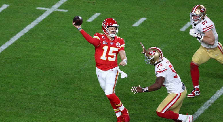 Feb 2, 2020; Miami Gardens, Florida, USA; Kansas City Chiefs quarterback Patrick Mahomes (15) throws on the run in Super Bowl LIV at Hard Rock Stadium. Mandatory Credit: Kim Klement-USA TODAY Sports
