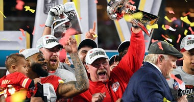 Feb 2, 2020; Miami Gardens, Florida, USA; Kansas City Chiefs head coach Andy Reid hoist the Vince Lombardi Trophy after defeating the San Francisco 49ers in Super Bowl LIV at Hard Rock Stadium. Credit: Robert Deutsch-USA TODAY Sports