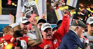 Feb 2, 2020; Miami Gardens, Florida, USA; Kansas City Chiefs head coach Andy Reid hoist the Vince Lombardi Trophy after defeating the San Francisco 49ers in Super Bowl LIV at Hard Rock Stadium. Credit: Robert Deutsch-USA TODAY Sports