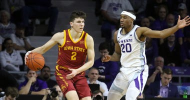 Mar 7, 2020; Manhattan, Kansas, USA; Iowa State Cyclones guard Caleb Grill (2) is guarded by Kansas State Wildcats forward Xavier Sneed (20) during the first half at Bramlage Coliseum. Scott Sewell-USA TODAY Sports