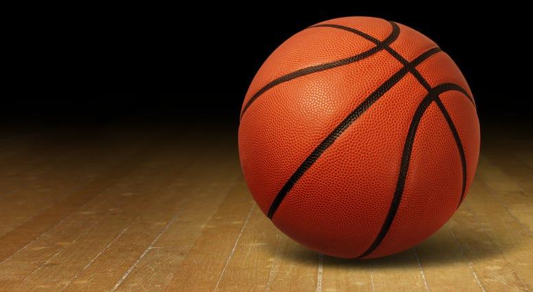 A basketball on a wooden floor