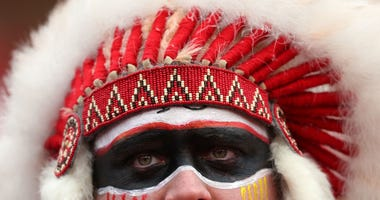 A fan in a headdress looks on prior to the AFC Divisional playoff game between the Kansas City Chiefs and the Houston Texans at Arrowhead Stadium on January 12, 2020 in Kansas City, Missouri
