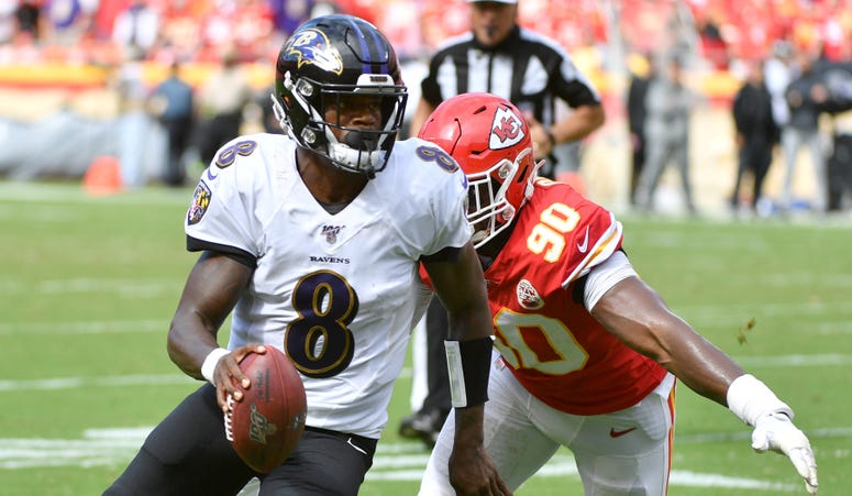 Sep 22, 2019; Kansas City, MO, USA; Baltimore Ravens quarterback Lamar Jackson (8) runs in for a touchdown as Kansas City Chiefs defensive end Emmanuel Ogbah (90) attempts the tackle during the second half at Arrowhead Stadium. Mandatory Credit: Denny Med