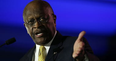 Herman Cain, former chairman and chief executive officer of Godfather's Pizza, speaks during the final day of the 2014 Republican Leadership Conference on May 31, 2014