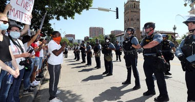 Demonstrators and police face each other during a protest at the Country Club Plaza on May 31, 2020 in Kansas City, Missouri.
