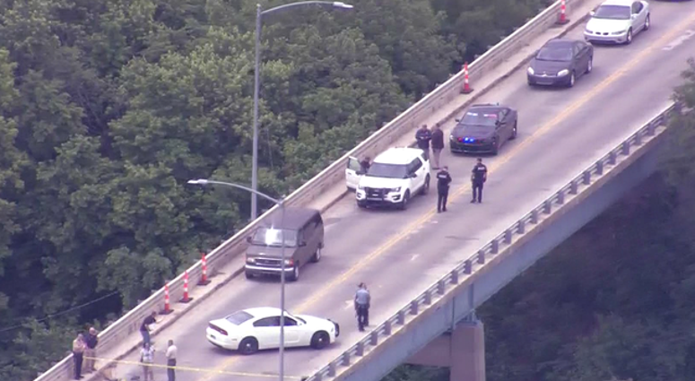 A helicopter view of a bridge in Leavenworth, KS where a gunman was stopped by an Army soldier by running over him.