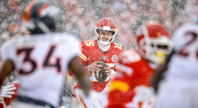 KC Chiefs quarterback Patrick Mahomes at Arrowhead in the snow during a game against the NE Patriots
