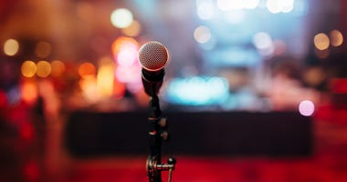 A view of a club from behind a microphone.