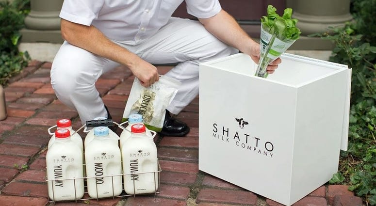 promotional image of milkman delivering milk and produce