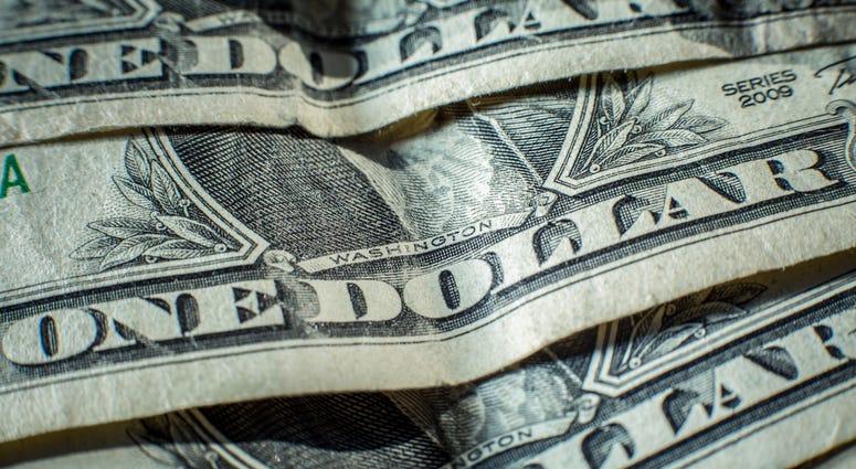 a close up of dollar bills