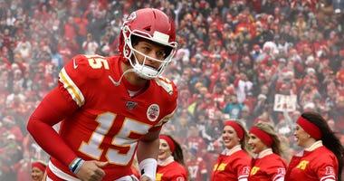 Patrick Mahomes of the Kansas City Chiefs runs onto the field