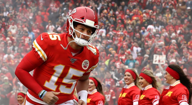 Patrick Mahomes of the Kansas City Chiefs runs onto the field