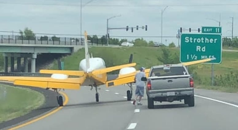 A small plane after landing on the interstate