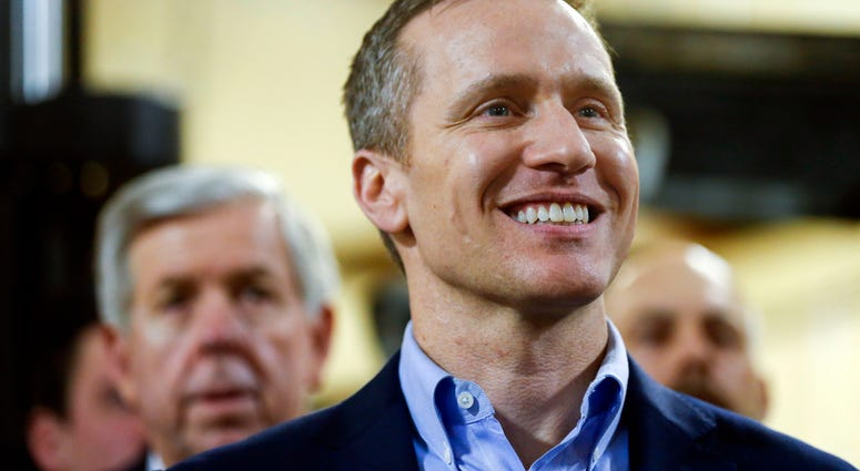 Gov Eric Greitens smiles during an event