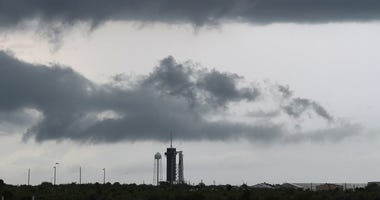Dark clouds hang over the SpaceX Falcon 9 rocket with the manned Crew Dragon spacecraft on launch pad 39A at the Kennedy Space Center on May 27, 2020 in Cape Canaveral, Florida.