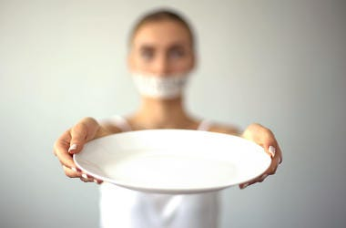 woman holding an empty plate