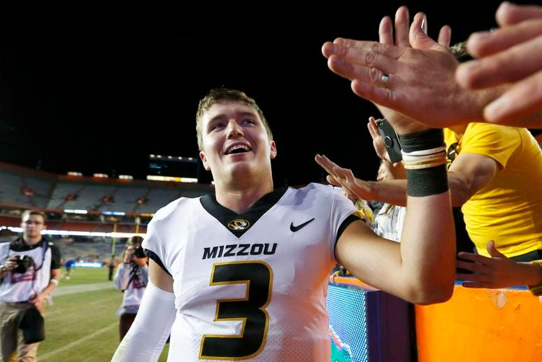 Nov 3, 2018; Gainesville, FL, USA; Missouri Tigers quarterback Drew Lock (3) celebrates with fans in the stands after defeating the Florida Gators at Ben Hill Griffin Stadium. Kim Klement-USA TODAY Sports