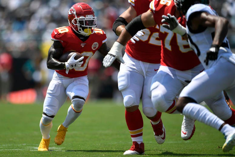 Chiefs receiver Tyreek Hill carries the ball against the Jacksonville Jaguars